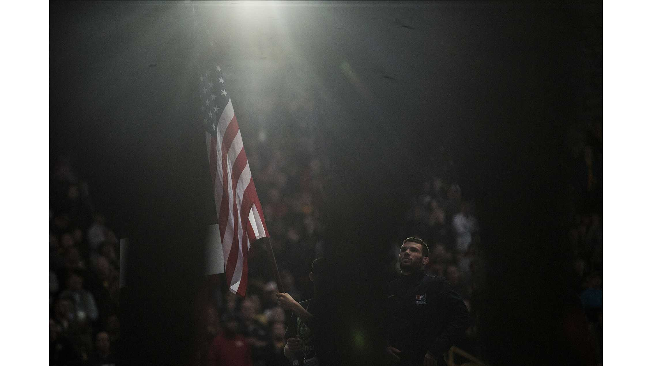 America's Thomas Gilman stands during the national anthem before Session 2 of the 2018 Men's Freestyle World Cup at Carver-Hawkeye Arena on Saturday, April 7. (Ben Allan Smith/The Daily Iowan)