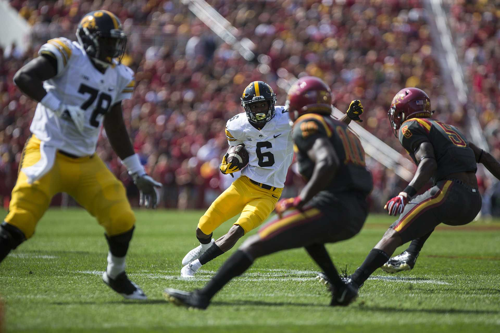 Iowa's Ihmir Smith-Marsette avoids tackles during the Iowa State game at Jack Trice Stadium on Saturday, Sept. 9, 2017.