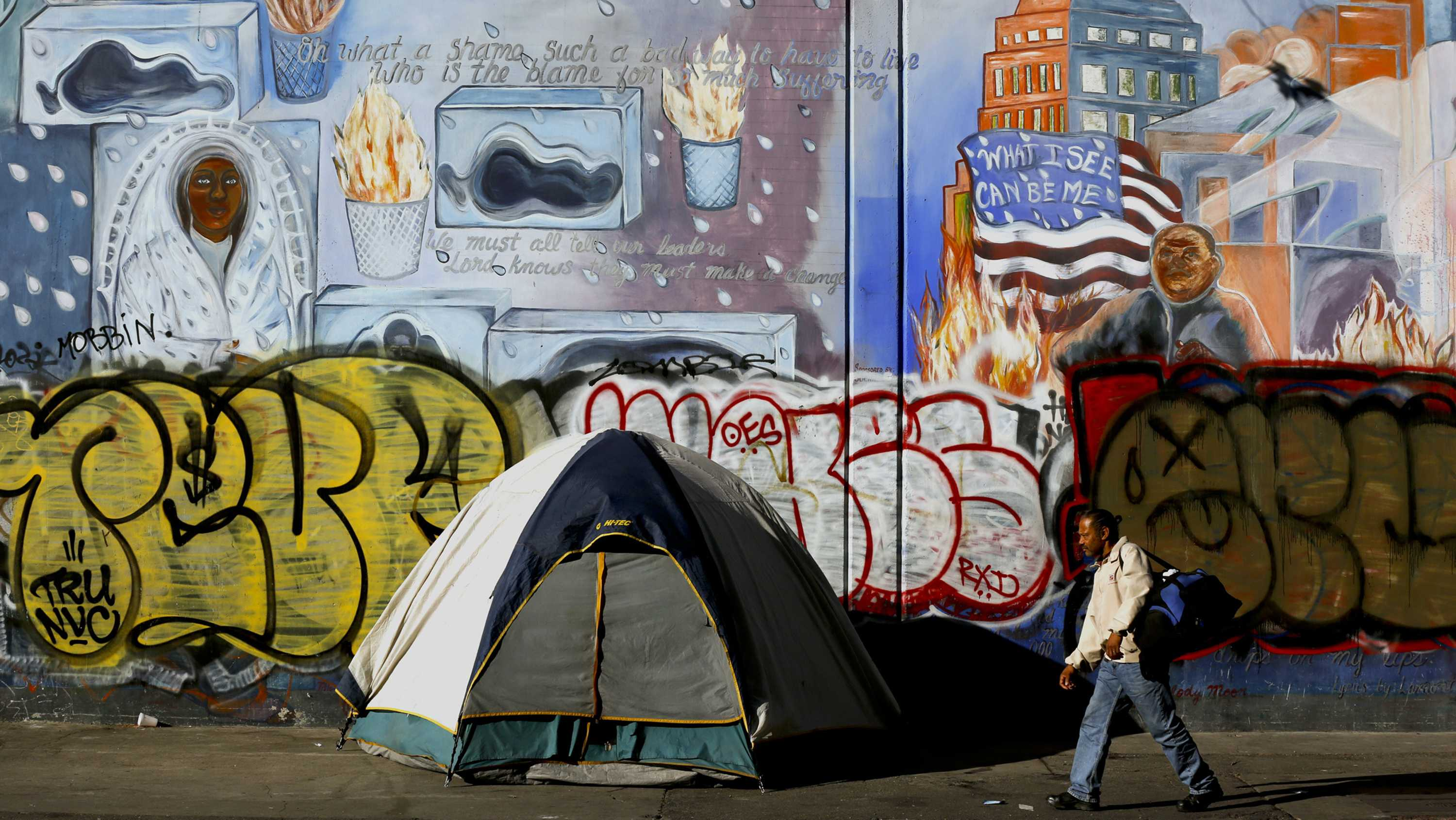Everything is quiet along 5th Street in downtown Los Angeles, Calif. prior to the sweeps by Los Angeles police officers and sanitation workers who were clearing out the homeless and their belongings, then power washing the sidewalks and gutters, on April 18, 2016. (Mark Boster/Los Angeles Times/TNS)