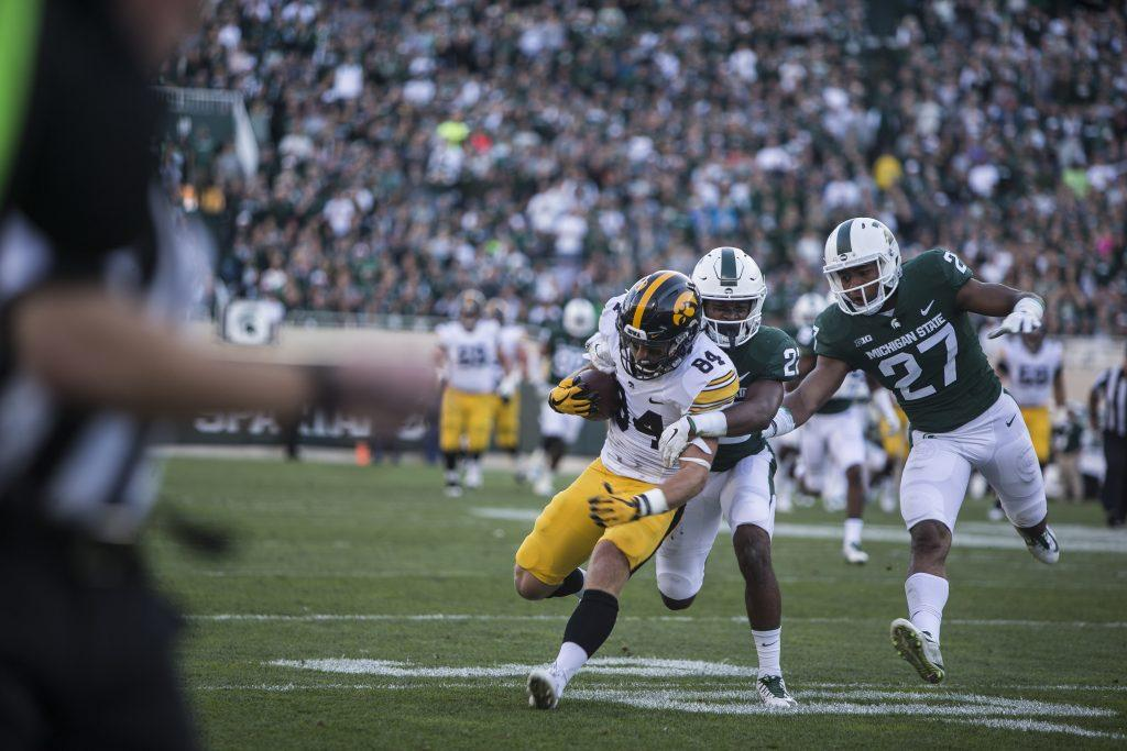 Iowa+wide+receiver+Nick+Easley+is+tackled+by+players+on+the+Michigan+State+defense+during+the+game+between+Iowa+and+Michigan+State+at+Spartan+Stadium+on+Saturday%2C+Sept.+30%2C+2017.+The+Hawkeyes+fell+to+the+Spartans+with+a+final+score+of+10-17.+%28Ben+Smith%2FThe+Daily+Iowan%29