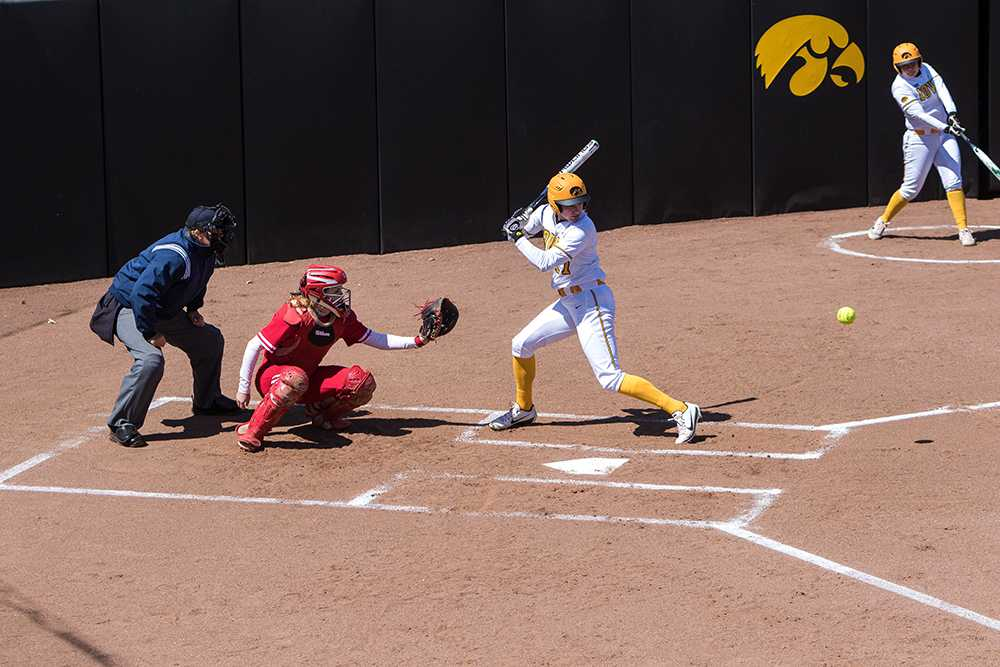 Allie+Wood+watches+a+pitch+during+a+game+against+the+University+of+Wisconsin+on+Saturday%2C+Apr.+7%2C+2018.+The+Hawkeyes+defeated+the+Badgers+3-0.+%28David+Harmantas%2FThe+Daily+Iowan%29