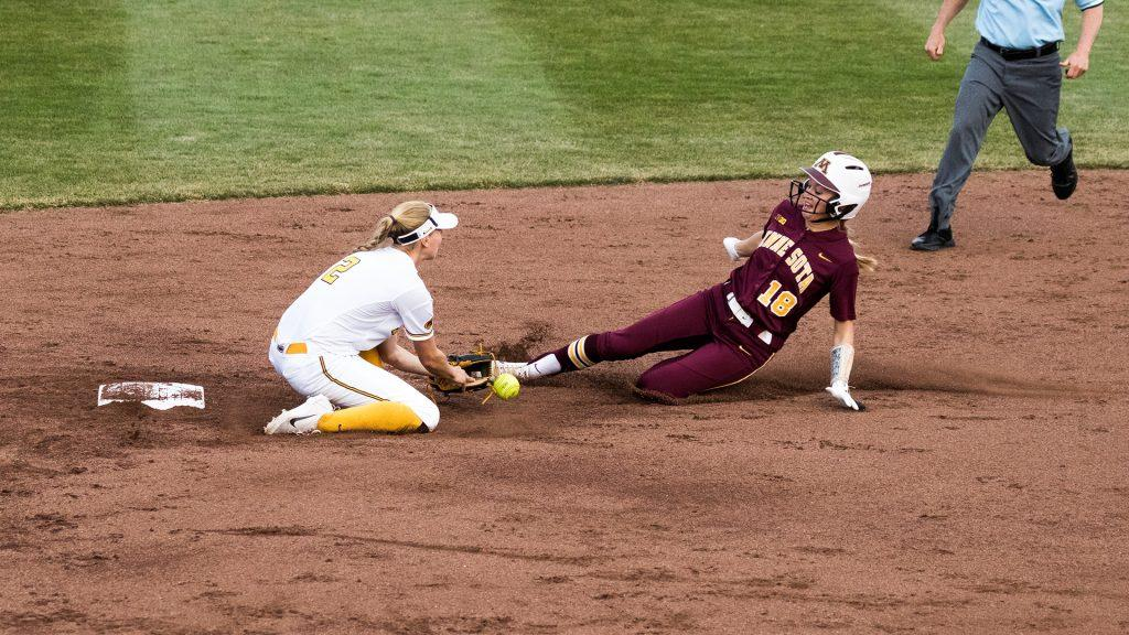 University+of+Iowa+softball+player+Aralee+Bogar+drops+the+ball+during+a+game+against+the+University+of+Minnesota+on+Thursday%2C+Apr.+12%2C+2018.+The+runner+was+safe+at+second+base+and+the+Gophers+defeated+the+Hawkeyes+8-0.+%28David+Harmantas%2FThe+Daily+Iowan%29
