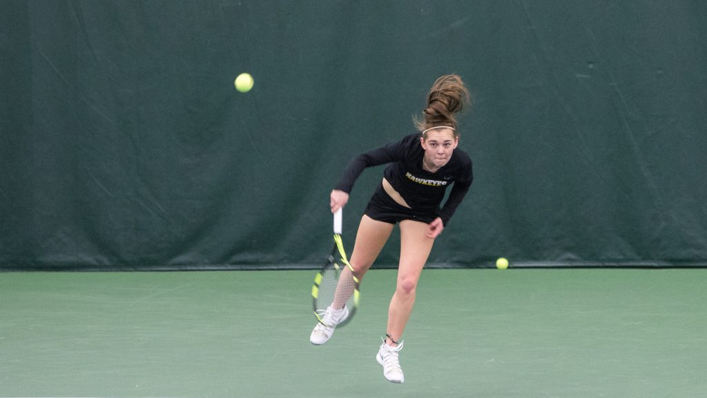 Iowa+tennis+player+Zoe+Douglas+returns+the+ball+during+a+match+against+Marquette+University+on+Sunday%2C+Feb.+25%2C+2018+at+the+Hawkeye+Tennis+Complex.+Iowa+swept+the+match+and+Douglas+won+her+match+6-3%2C+6-3.+%28David+Harmantas%2FThe+Daily+Iowan%29