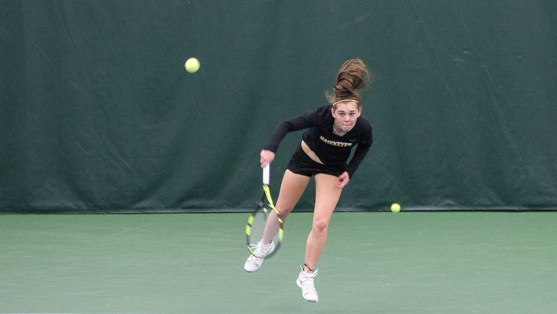 Iowa tennis player Zoe Douglas returns the ball during a match against Marquette University on Sunday, Feb. 25, 2018 at the Hawkeye Tennis Complex. Iowa swept the match and Douglas won her match 6-3, 6-3. (David Harmantas/The Daily Iowan)