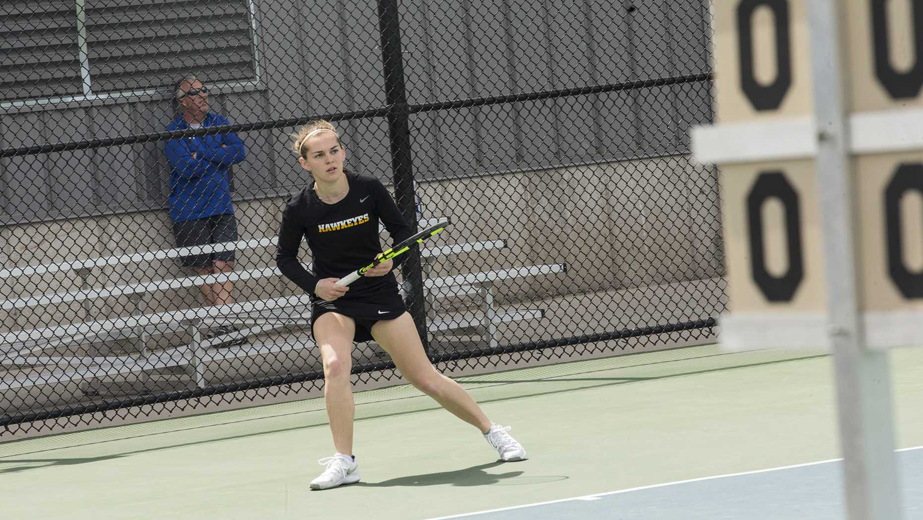 Iowa's Zoe Douglas waits to return the ball during the women's tennis match between Iowa and Wisconsin at the Klotz Tennis Courts on Sunday, April 22, 2018. The Hawkeyes lost to the Badgers, 4-1. (Chris Kalous/The Daily Iowan)
