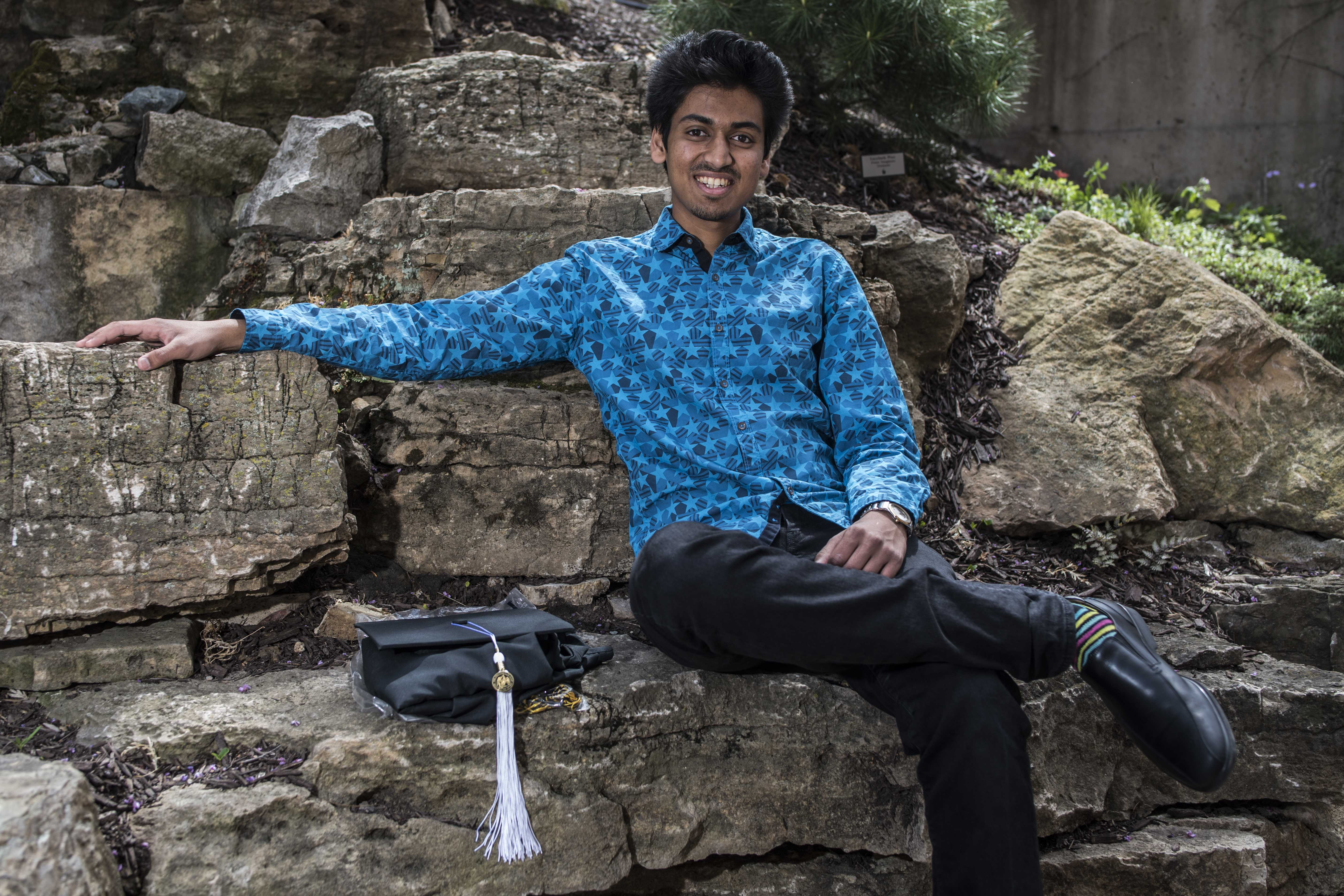 UI senior Akash Bhalerao poses for a portrait in the Dancer's Garden on Tuesday, May 8. Bhalerao is graduating with degrees in both social entrepreneurship and environmental restoration. (Ben Allan Smith/The Daily Iowan)