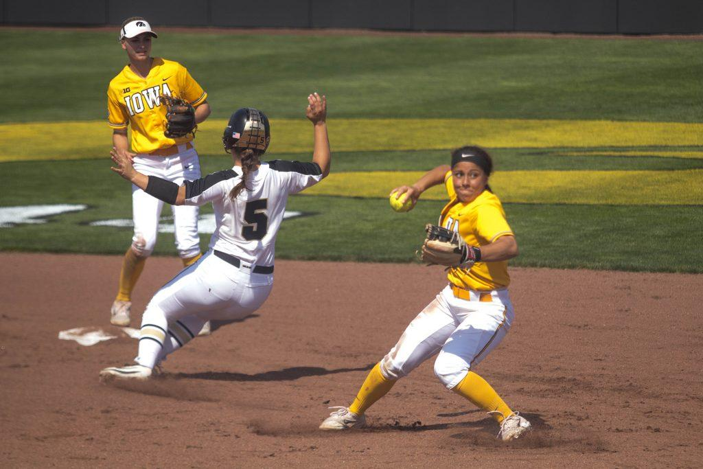 Lea+Shaw+throws+to+first+base+during+Iowa%27s+game+against+Purdue+at+Pearl+Field+on+May+5%2C+2018.+The+Hawkeyes+were+defeated+9-0.+%28Megan+Nagorzanski%2FThe+Daily+Iowan%29
