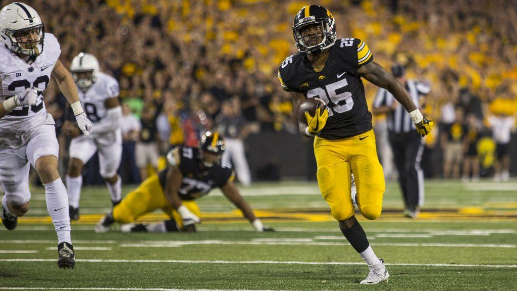 Iowa+running+back+Akrum+Wadley+breaks+free+for+a+touchdown+run+during+Iowa%27s+game+against+Penn+State+at+Kinnick+Stadium+on+Sept.+23%2C+2017.+Penn+State+defeated+Iowa+21-19+on+a+last+second+touchdown+past.+%28Nick+Rohlman%2FThe+Daily+Iowan%29