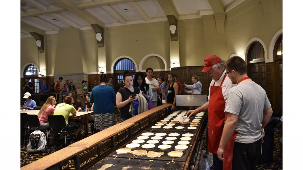 Students+wait+in+line+for+breakfast+at+the+Iowa+Memorial+on+Monday%2C+May+7%2C+2018.+%22Flippin%27+into+Finals%22+featured+the+Pancake+Man+who+frequently+tossed+pancakes+to+students+in+the+air.+%28Sid+Peterson%2FThe+Daily+Iowan%29
