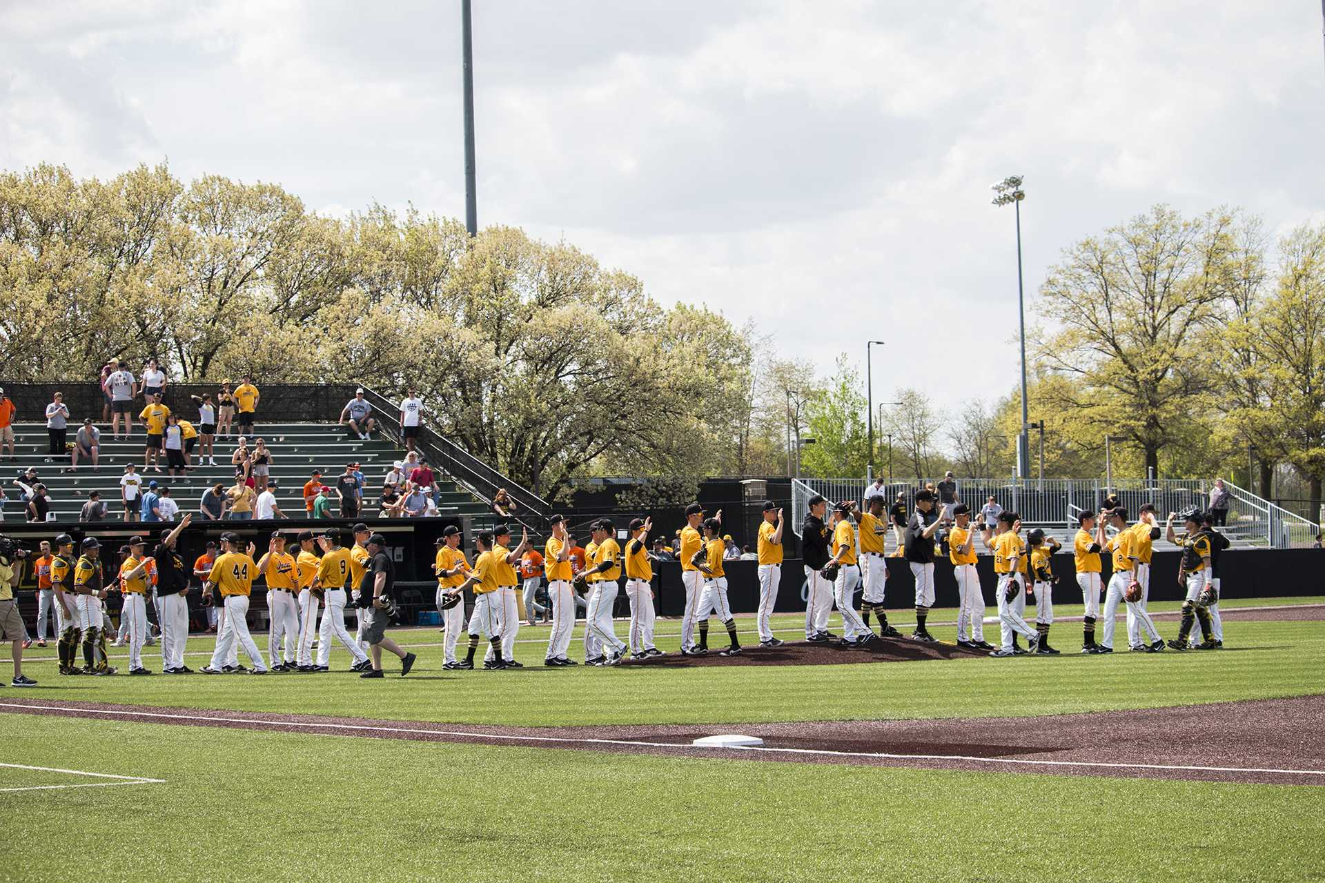 Iowa players congratulate each other on the win during baseball Iowa vs. Oklahoma State at Duane Banks Field on May 6, 2018. The Hawkeyes defeated the Cowboys 11-3.  (Katina Zentz/The Daily Iowan)