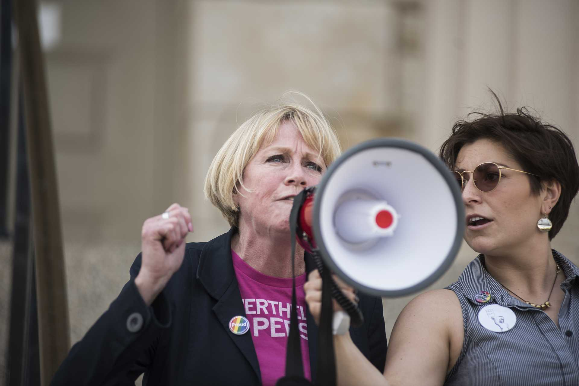Gubernatorial candidate Cathy Glasson speaks to a crowd on the Pentacrest in Iowa City on Saturday, May 5. Glasson is running on a platform that focuses on issues relating to universal healthcare, gun regulations, and equal pay. (Ben Allan Smith/The Daily Iowan)