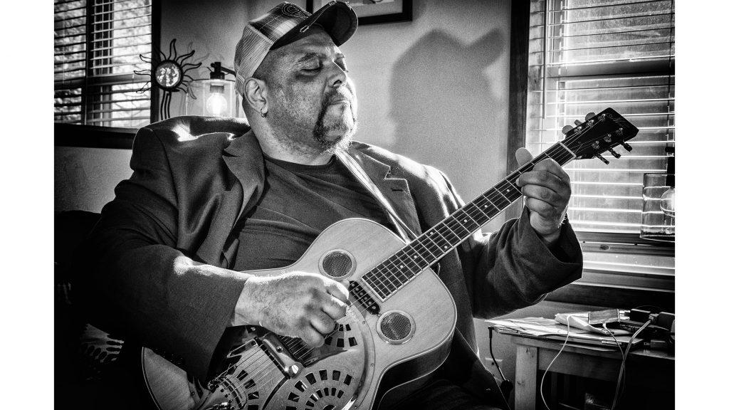 Blues+musician+Kevin+Burt+poses+for+a+portrait+in+his+Coralville+home+on+Wednesday%2C+Feb.+7%2C+2018.+Burt+recently+won+awards+in+the+acoustic+category+at+the+International+Blues+Festival+in+Memphis.+%28Nick+Rohlman%2FThe+Daily+Iowan%29