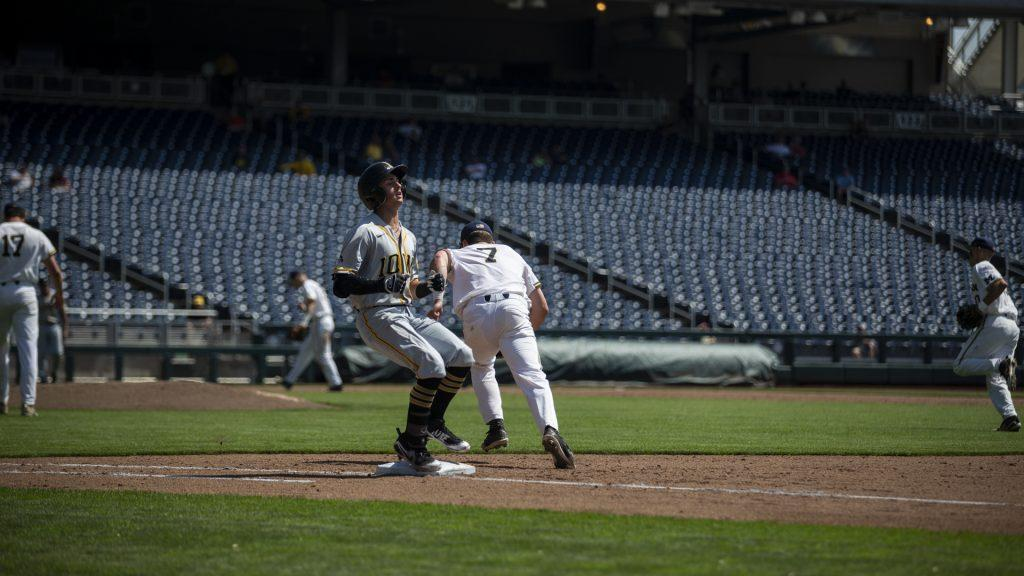 Iowa%27s+Ben+Norman+reacts+after+being+thrown+out+at+first+during+Iowa%27s+Big+Ten+tournament+Game+against+Michigan+at+TD+Ameritrade+Park+in+Omaha%2C+Neb.+on+Wed.+May+23%2C+2018.+The+Wolverines+defeated+the+Hawkeyes+2-1+in+extra+innings.+%28Nick+Rohlman%2FThe+Daily+Iowan%29