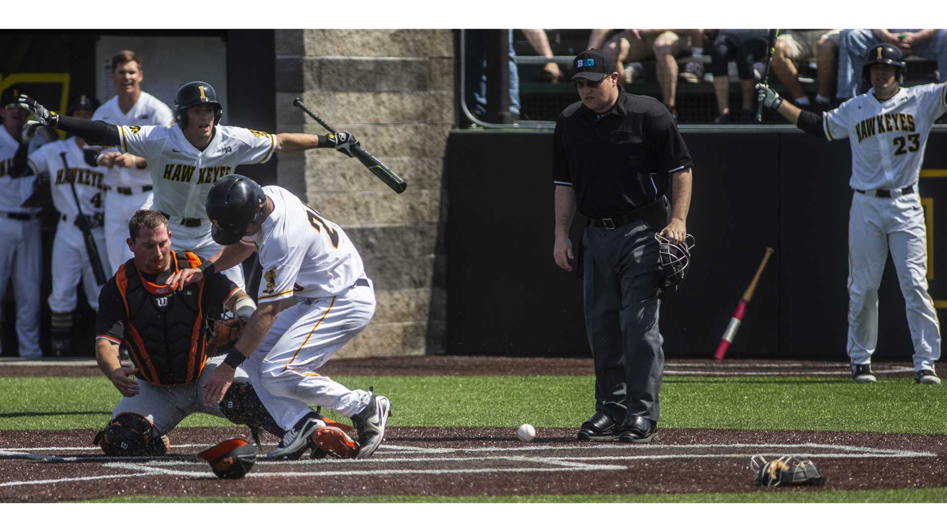 Iowa's Austin Guzzo collides with the catcher at home plate during Iowa's game against Oklahoma State at Duane Banks Field on Saturday May 5, 2018. The Hawkeyes defeated the Cowboys 16-14. (Nick Rohlman/The Daily Iowan)