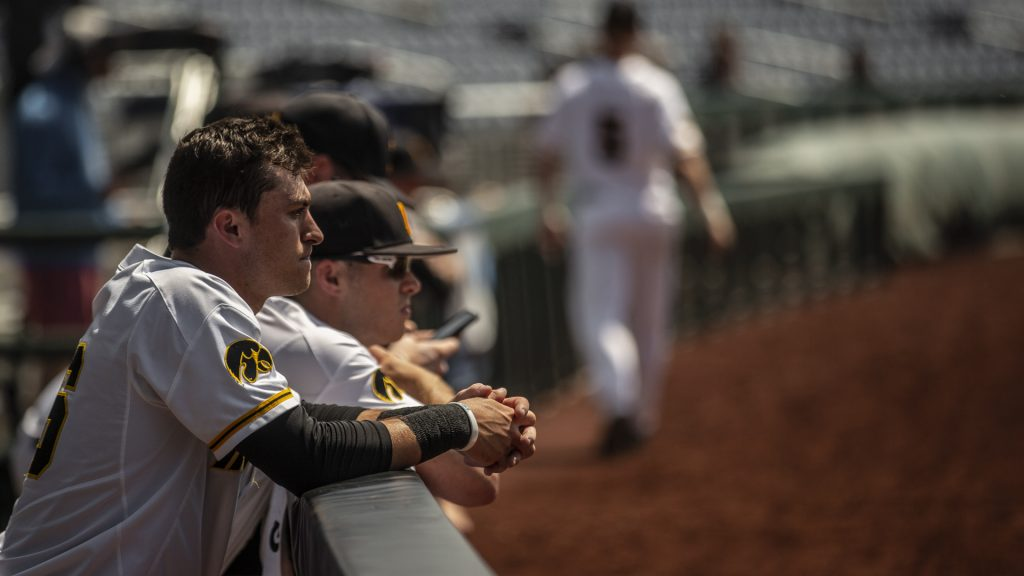 Iowa+players+lean+on+the+dugout+railing+after+Iowa%27s+Big+Ten+tournament+game+against+Ohio+State+on+Thursday%2C+May+24%2C+2018.+The+Buckeyes+defeated+the+Hawkeyes+2-0.+%28Nick+Rohlman%2FThe+Daily+Iowan%29