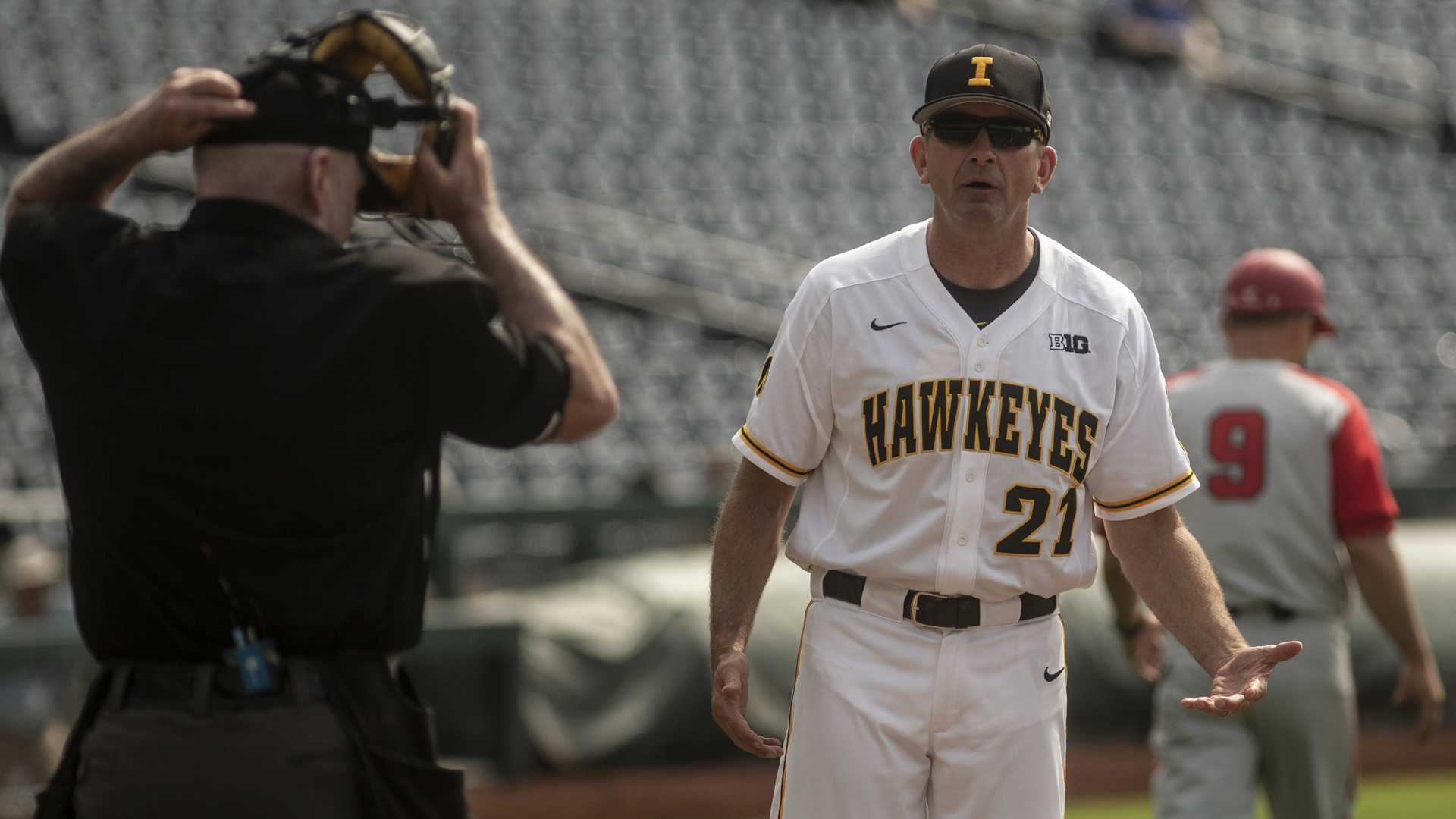 Iowa Head Coach Rick Heller questions the Home Plate Umpire during Iowa's Big Ten tournament game against Ohio State on Thursday, May 24, 2018. The Buckeyes defeated the Hawkeyes 2-0. (Nick Rohlman/The Daily Iowan)