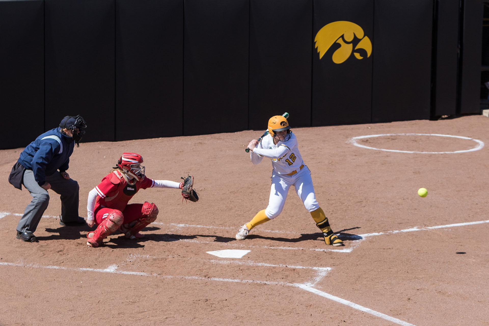 University of Iowa softball player Angela Schmiederer watches a pitch during a game against the University of Wisconsin on Saturday, Apr. 7, 2018. The Hawkeyes defeated the Badgers 3-0. (David Harmantas/The Daily Iowan)