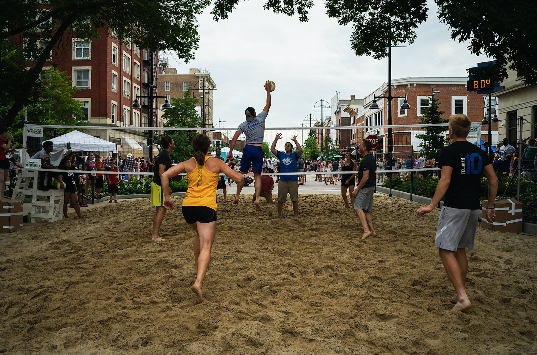 Partygoers participate in the volleyball tournament at the second annual Iowa City Downtown District Block Party on Saturday, June 23. The event, which allowed open containers in select downtown areas, attracted thousands of attendees. (Matthew Finley/The Daily Iowan)