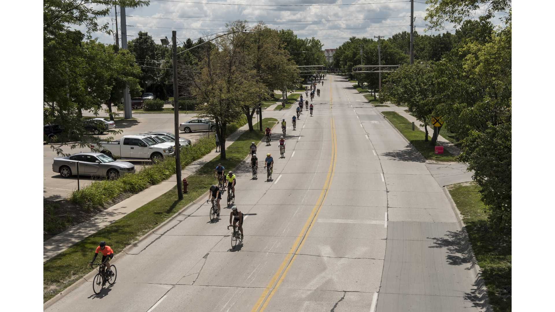 Cyclists ride on Gilbert Street in Iowa City, Iowa during RAGBRAI on Friday, July 27, 2018. Riders rode from Sigourney to Iowa City on Day 6 of this years ride. (Nick Rohlman/The Daily Iowan)