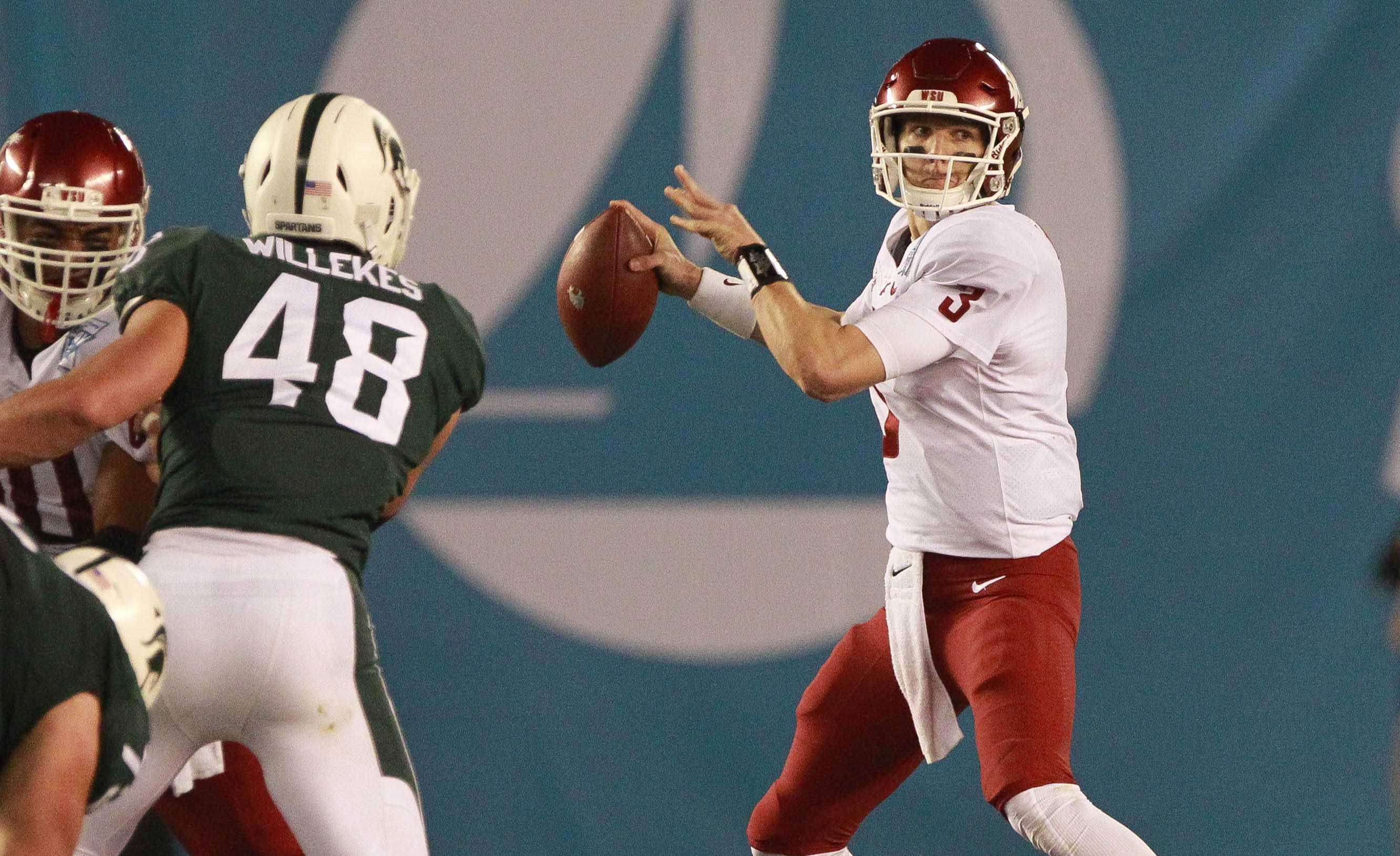 Washington State quarterback Tyler Hilinski, right, looks to pass against Michigan State during the Holiday Bowl at SDCCU Stadium in San Diego on Dec. 28, 2017. (Hayne Palmour IV/San Diego Union-Tribune/TNS)