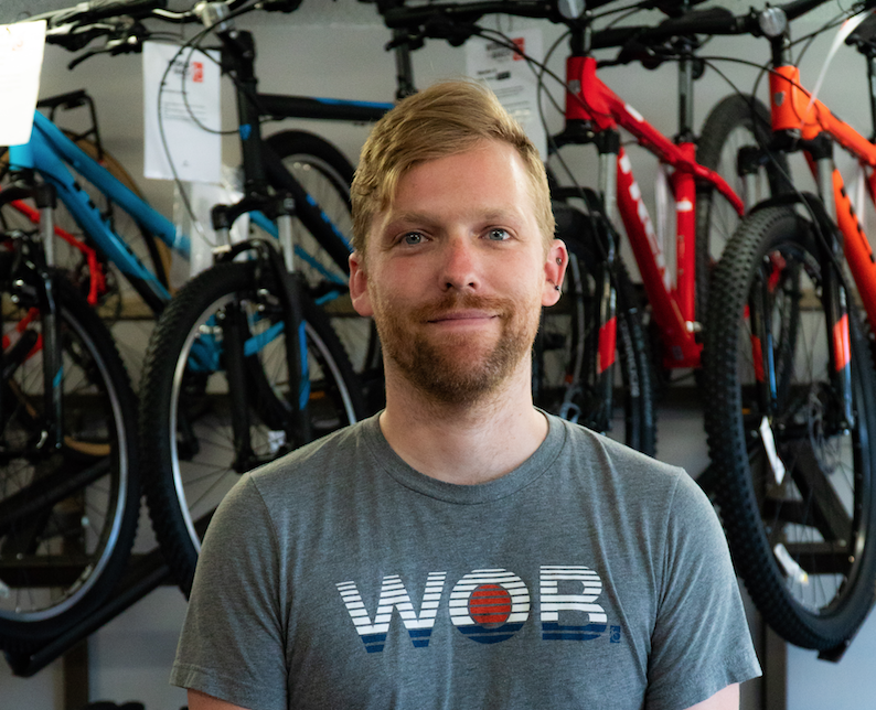 On+July+10%2C+2018+in+Iowa+City+World+of+Bikes+employee+Aaron+Weiner+will+ride+Ragbrai+with+friends.+He+looks+forward+to+being+able+to+sleep+in+his+own+bed+when+ragbrai+comes+through+Iowa+City.+%28Roman+Slabach%2FThe+Daily+Iowan%29