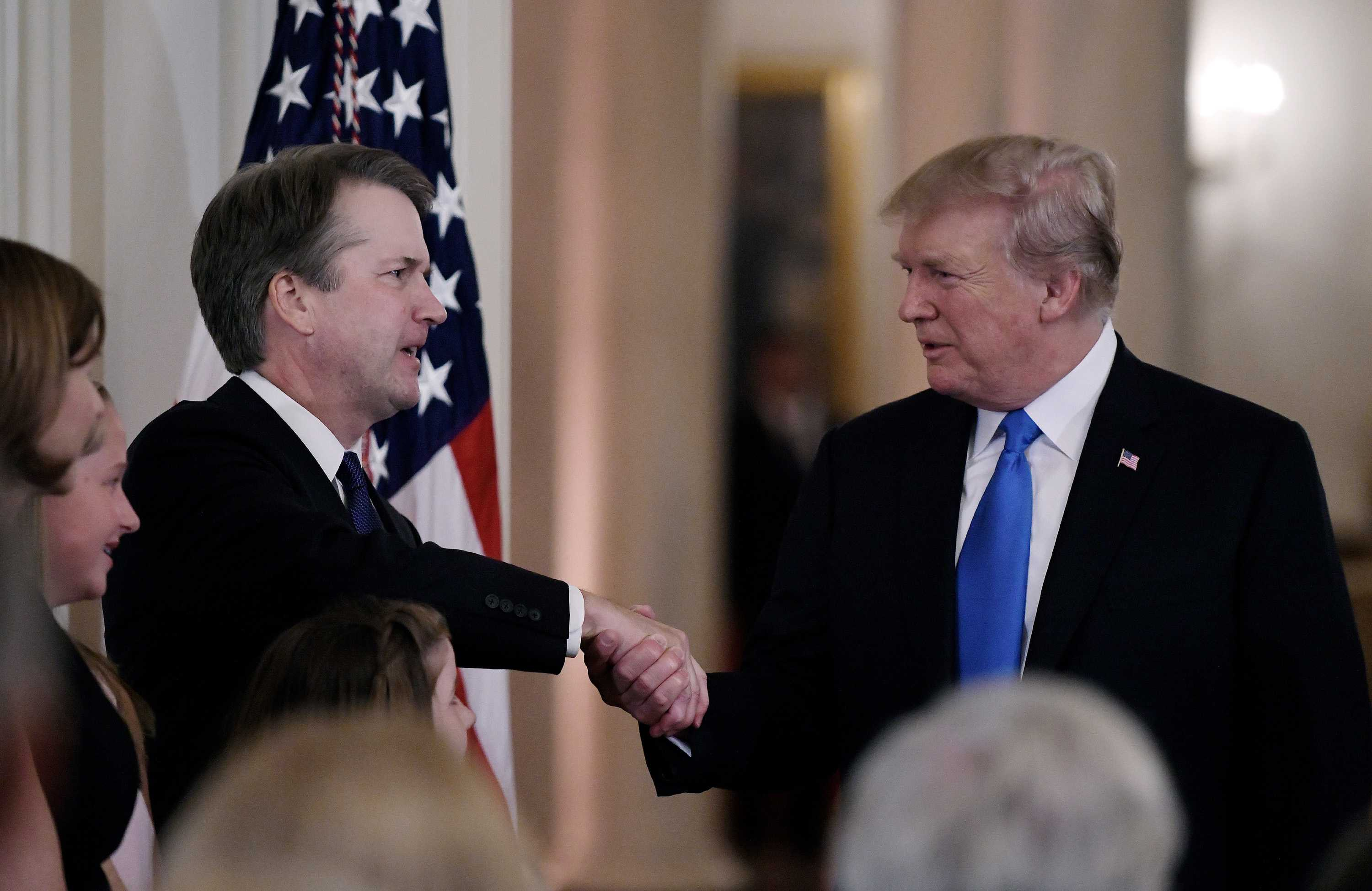U.S. President Donald Trump shakes hands with Judge Brett Kavanaugh with after he nominated him to the Supreme Court during a ceremony in the East Room of the White House July 9, 2018 in Washington, D.C. (Olivier Douliery/Abaca Press/TNS)