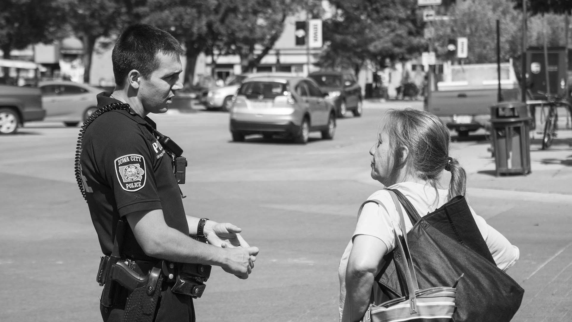 Officer Travis Graves speaks to a local citizen while on patrol downtown on Wednesday, July 25, 2018. Officer Graves is Iowa City's new Community Outreach Officer. The Community Outreach Officer provides additional coverage of downtown prior to the Night Shift Officer. (Tate Hildyard/The Daily Iowan)