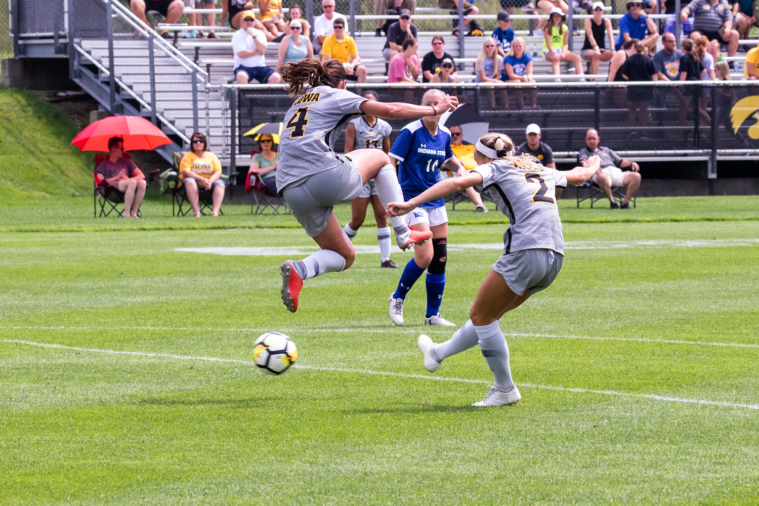 Iowa soccer player Kaleigh Haus jumps over the ball as Hailey Rydberg tries to center it during a game against Indiana State University on Sunday, Aug. 26, 2018. The Hawkeyes defeated the Sycamores 1-0.