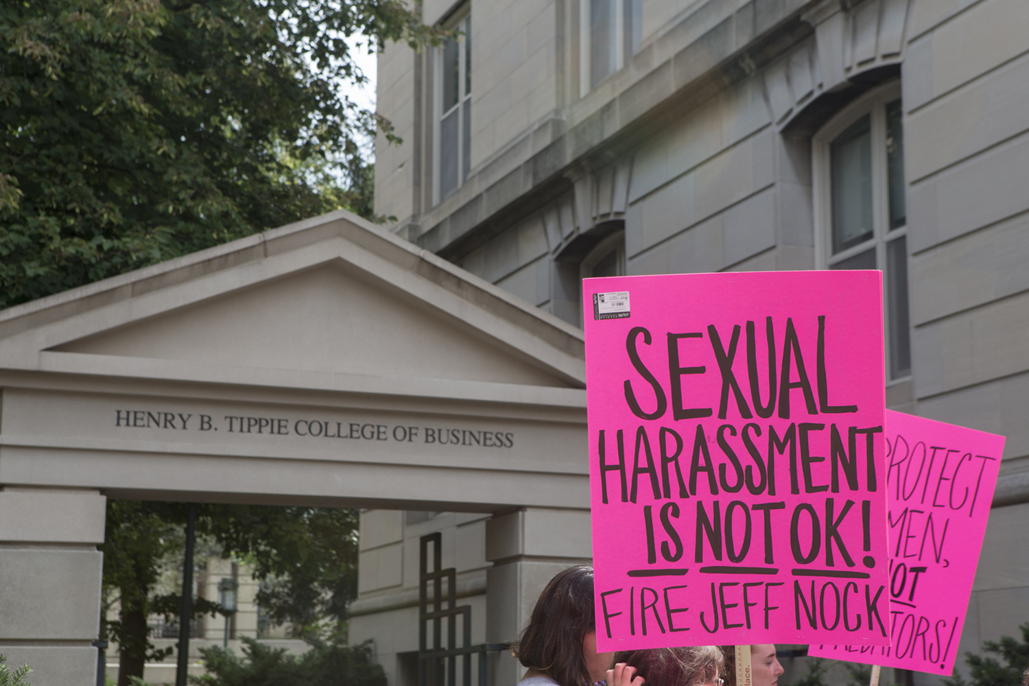 A protester holds their sign during the Jeffery Nock protest outside of the Pappajohn Business Building on Aug. 30, 2018. Students and faculty turned out to protest Professor Jeffery B. Nock, who is still employed at the university despite issued a criminal trespass warning after allegedly taking photographs of women at the Campus Recreation and Wellness Center.