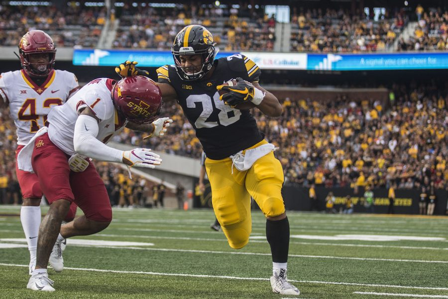 Iowa%27s+Toren+Young+attempts+to+stop+Iowa+State%27s+D%27Andre+Payne%27s+tackle+during+the+Iowa%2FIowa+State+football+game+at+Kinnick+Stadium+on+Saturday%2C+September+8%2C+2018.+The+Hawkeyes+defeated+the+Cyclones%2C+13-3.