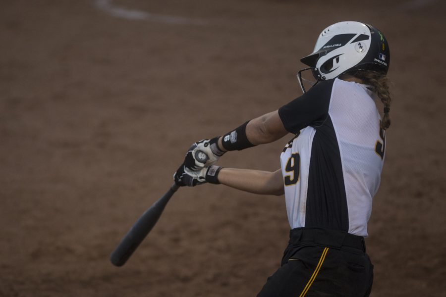 Freshman+Abby+Lien%2C+utiliy+and+center%2C+bats+during+the+Iowa+v+Kirkwood+softball+game+at+the+Pearl+Softball+Complex+in+Coralville+on+Sept+14%2C+2018.+The+Hawkeyes+defeated+the+Kirkwood+Eagles+10-6.+