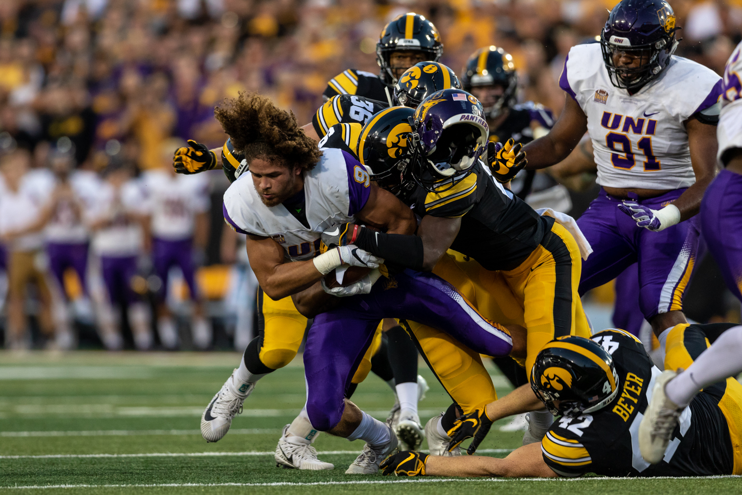 A Northern Iowa player loses his helmet as the Iowa defense swarms in the first half of a football game against the University of Northern Iowa at Kinnick Stadium on Saturday, Sep. 15, 2018. At halftime, the Hawkeyes led the Panthers 21-0. (David Harmantas/The Daily Iowan)