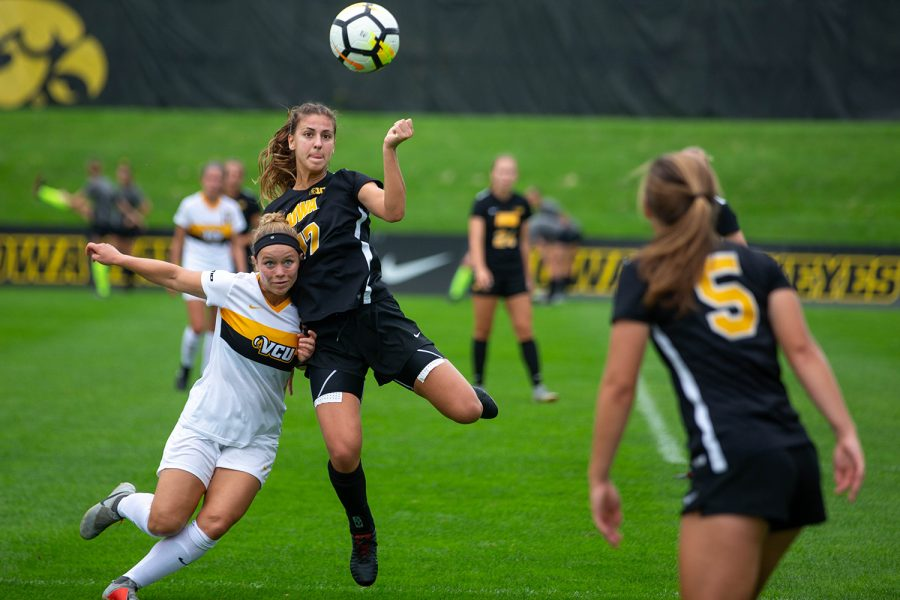 Defender+Hannah+Drkulec+fights+for+the+ball+during+a+game+against+Virginia+Commonwealth+University+on+Sept.+2%2C+2018.+The+Hawkeyes+won+the+match+2-0.+