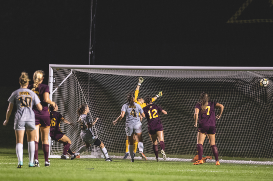 Players+look+on+as+Iowa+midfielder+Josie+Durr%E2%80%99s+shot+finds+the+back+of+the+net+during+Iowa%E2%80%99s+game+against+Central+Michigan+on+Aug.+31+at+the+Iowa+Soccer+Complex.+The+Hawkeyes+defeated+the+Chippewas%2C+3-1.