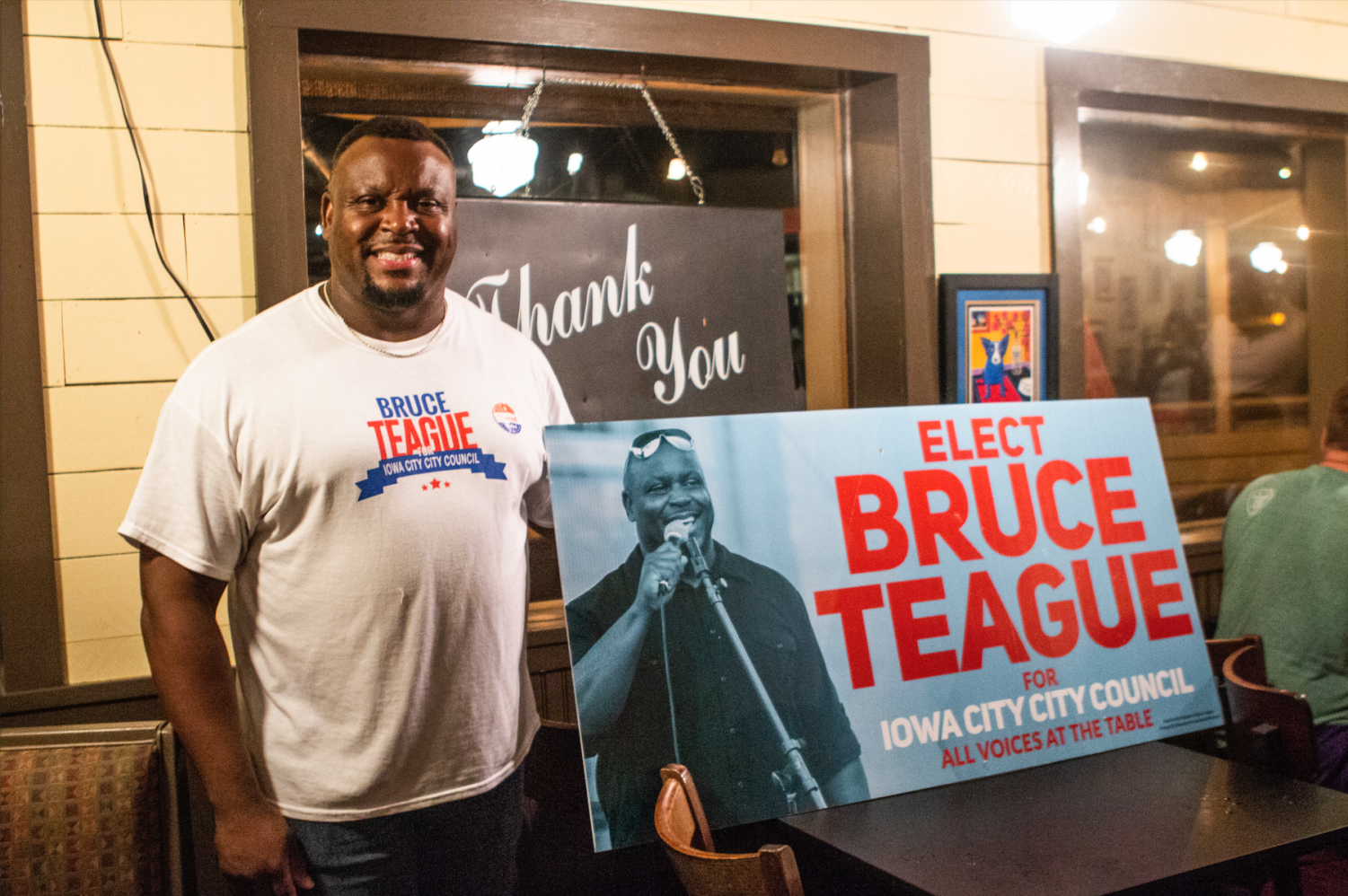 City Council candidate Bruce Teague stands by his election sign at Billy's High Hat Diner on Tuesday, September 4, 2018. Teague received the second highest number of votes overall.