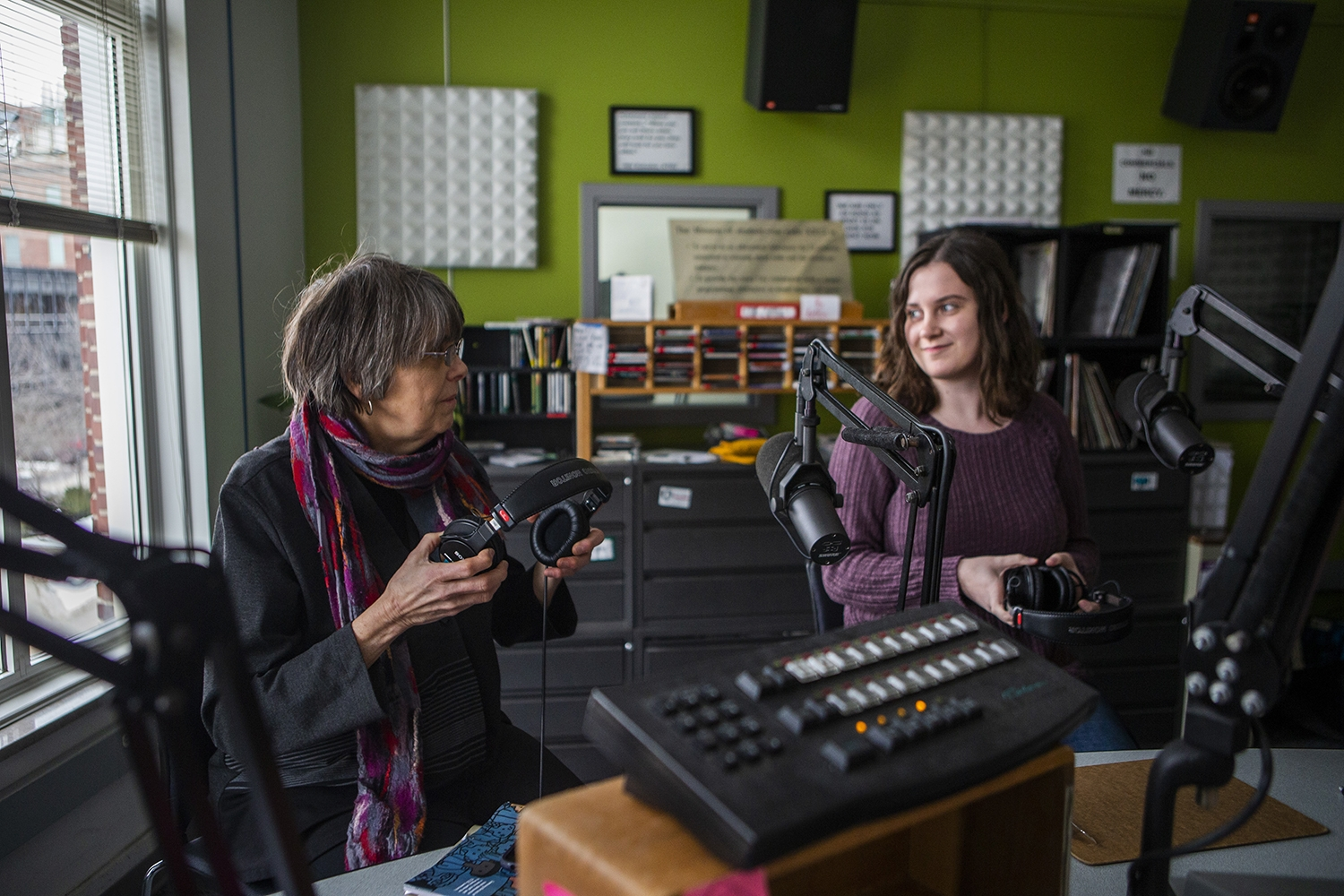 Mary Beth Tinker and DI managing editor Marissa Payne prepare to put on their headphones during an interview with the Tinkers at the KRUI studio on Tuesday, February 26, 2019. Mary Beth and John wore black arm bands to school in protest of the Vietnam War, leading to the Tinker vs. Des Moines court case in 1969.(Katina Zentz/The Daily Iowan)