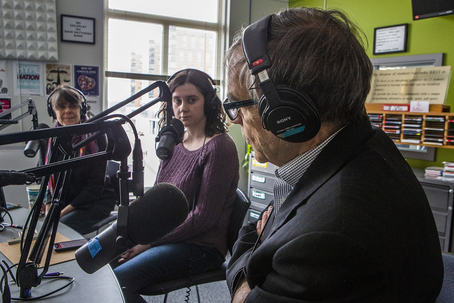 John Tinker answers questions during an interview with the Tinkers at the KRUI studio on Tuesday, February 26, 2019. John, and his sister Mary Beth, wore black arm bands to school in protest of the Vietnam War, leading to the Tinker vs. Des Moines court case in 1969. (Katina Zentz/The Daily Iowan)