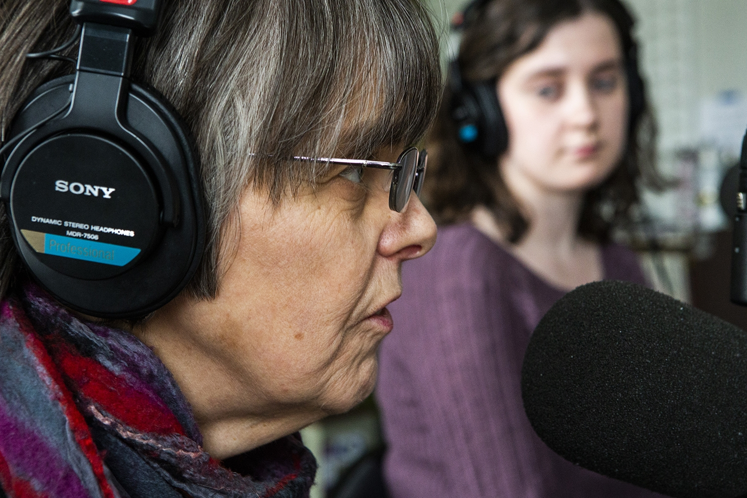 DI manager editor Marissa Payne listens to Mary Beth Tinker discuss the aspects of free speech during an interview with the Tinkers at the KRUI studio on Tuesday, February 26, 2019. Mary Beth, along with her brother John, wore black arm bands to school in protest of the Vietnam War, leading to the Tinker vs. Des Moines court case in 1969.(Katina Zentz/The Daily Iowan)