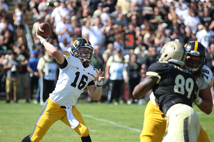 Iowa quarterback C.J. Beathard passes against Purdue in Ross-Ade Stadium on Sept. 27, 2014, in West Lafayette, Indiana. The Hawkeyes defeated the Boilermakers, 24-10. (The Daily Iowan/Joshua Housing)