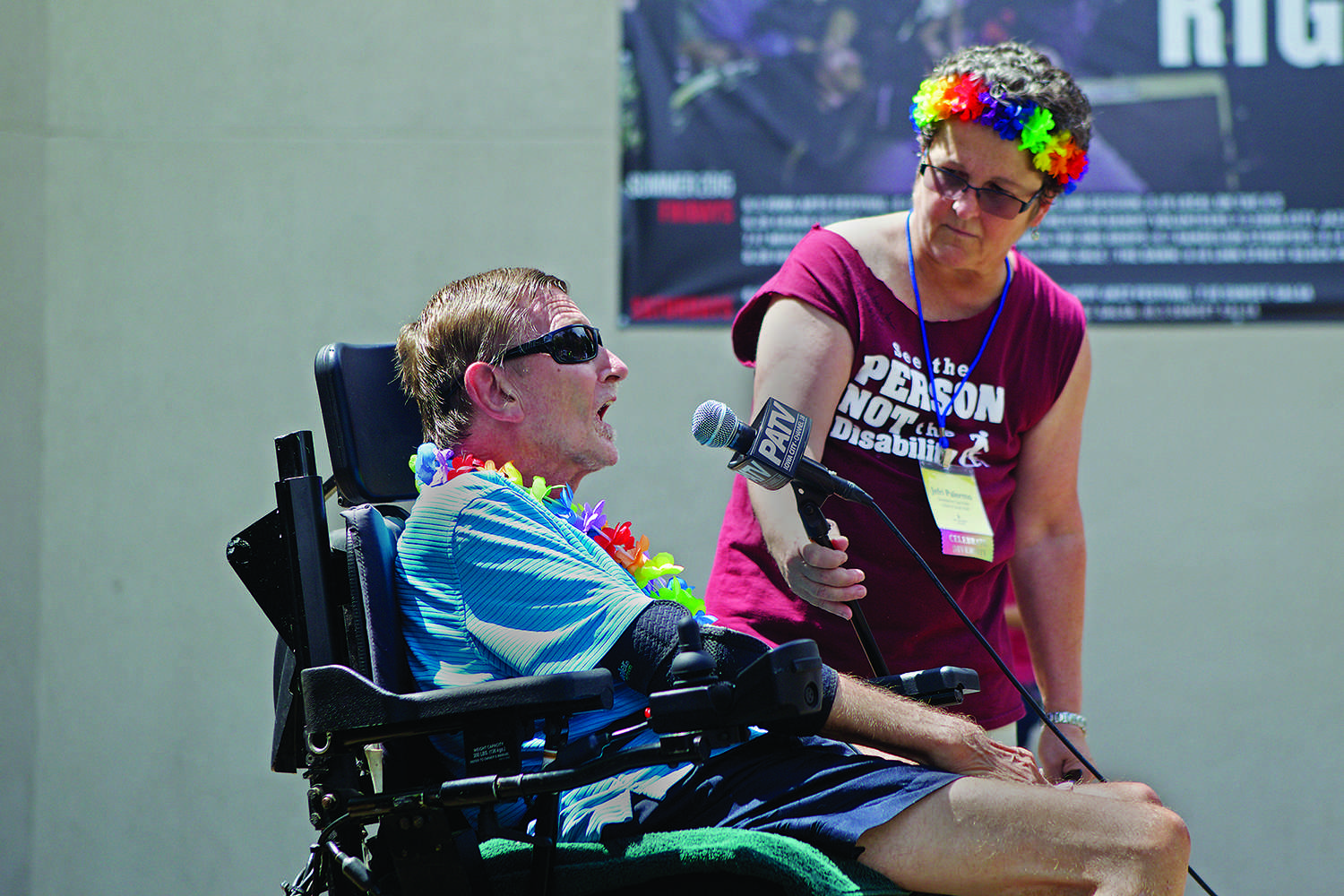 FILE - In this file photo, Keith Ruff talks at the Americans with Disability Act 25th Anniversary Celebration at the Ped Mall in Iowa City on Saturday July 25, 2015. The ADA is a civil rights law that bans discrimination against individuals with disabilities. (The Daily Iowan/Jai Yeon Lee, file)
