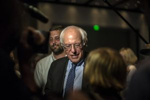 Vermont Senator Bernie Sanders looks out into the crowd as he is introduced at the 2015 Iowa Democratic Hal of Fame inside the Double Tree Hotel in Cedar Rapids on Friday, July 17, 2015. Sanders' campaign has seen a dramatic increase in support in the past weeks. (The Daily Iowan/Sergio Flores)