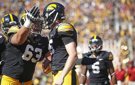 Iowa center Austin Blythe celebrates quarterback Jake Rudock's touchdown during the second quarter in Kinnick Stadium on Saturday, Sept. 13, 2014. Iowa State defeated Iowa, 20-17. (The Daily Iowan/Valerie Burke)