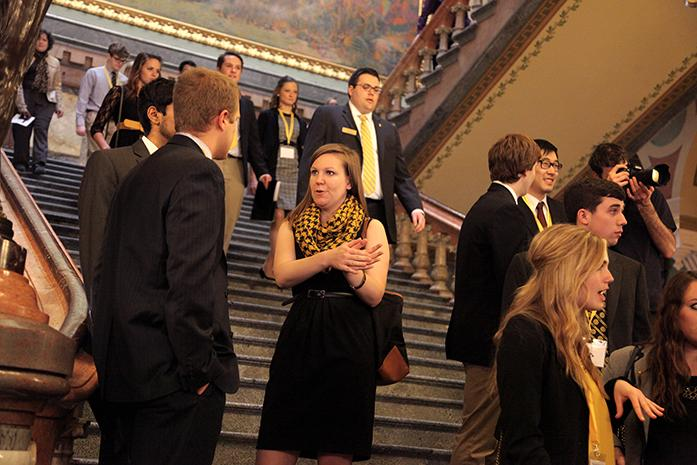 UISG+President+Katherine+Valdie+talks+with+fellow+Iowa+students+on+the+steps+of+the+Capital+Building+on+Wednesday%2C+April+2%2C+2014.