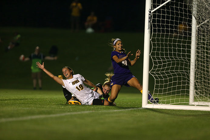 Iowa midfielder Karly Stuenkel scores the game-winning goal on her way down during the game on Tuesday, September 1. The Hawkeyes defeated the Panthers, 2-1 in overtime. (The Daily Iowan/Rachael Westergard)