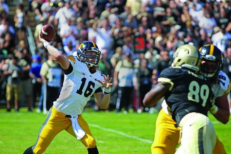 Iowa quarterback C.J. Beathard throws the ball against Purdue at Ross-Ade Stadium on Saturday, Sept. 27, 2014 in West Laffeyette, Indiana. The Hawkeyes defeated the Boilermakers, 24-10. (The Daily Iowan/Joshua Housing)