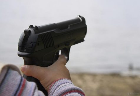 The gun in the hands of child