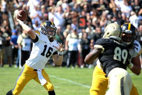 Iowa quarterback CJ Beathard throws the ball against Purdue at Ross-Ade Stadium on Saturday, Sep. 27, 2014 in West Laffeyette, Indiana. The Hawkeyes defeated the Boilermakers, 24-10. (The Daily Iowan/Joshua Housing)