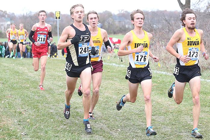 Purdue+runner+Caleb+Kerr+and+Iowa+runners+Nate+Ferree+and+Ben+Anderson+compete+against+each+other+at+the+Big+10+conference+cross+country+meet+on+Sunday%2C+Nov.+2%2C+2014.+Michigan+State+won+the+women%27s++title%2C+and+Wisconsin+claimed+the+men%27s+title.+For+individual+titles%2C+Michigan+State+runner+Leah+O%27Conner+won+the+women%27s+race%2C+and+Wisconsin+runner+Malachy+Schrobilgen+won+the+men%27s+race.+%28The+Daily+Iowan%2FJohn+Theulen%29