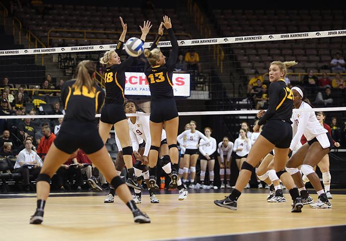 Iowa+State+middle+hitter+Samara+West+gets+the+ball+past+two+Iowa+blockers+Lauren+Brobst+and+Mikaela+Gunderson+during+the+Cy-Hawk+Series+in+Carver-Hawkeye+Arena+on+Friday%2C+Sept.+11%2C+2015.+The+Hawkeyes+defeated+the+Cyclones+for+the+first+time+in+18+years%2C+3-1.+%28The+Daily+Iowan%2FMargaret+Kispert%29