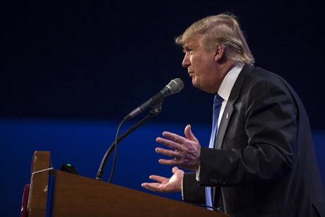 Donald Trump delivers a speech at the Lincoln Dinner in Des Moines on Saturday, May 16, 2015. Trump spoke critically about American business and commented on how